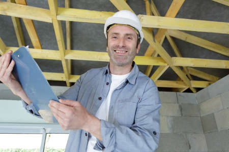 Photo pour a happy carpenter laughing at the camera - image libre de droit