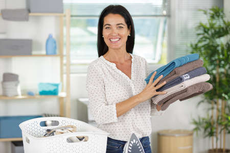 Foto de happy woman with fresh laundry - Imagen libre de derechos