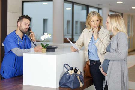 Photo pour Pregnant girl at the doctors reception - image libre de droit
