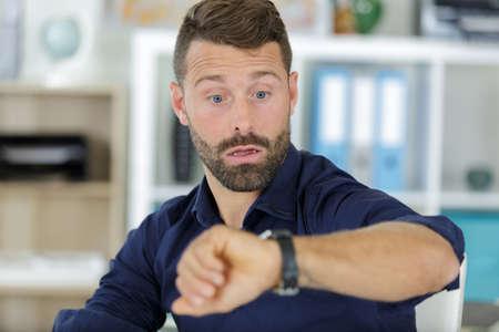 Photo pour man checking time his watch - image libre de droit