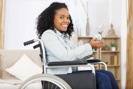Photo pour Happy disabled woman in wheelchair - image libre de droit