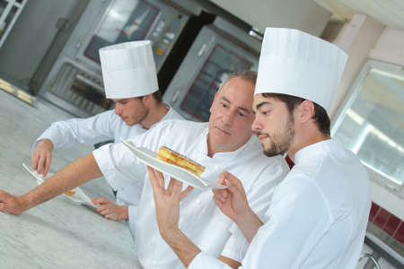 Photo for focused chef preparing a cake in the restaurant kitchen - Royalty Free Image
