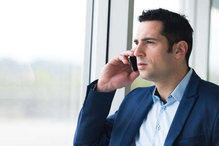 Photo for portrait of a businessman on cell phone - Royalty Free Image