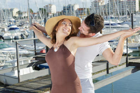 Photo pour woman and her beloved hugging in the port - image libre de droit