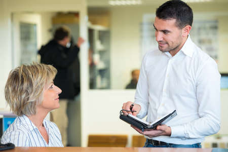 Photo pour Man and woman in a modern business center - image libre de droit