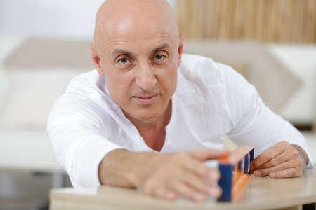 Photo pour portrait of a craftsman smiling at the camera - image libre de droit
