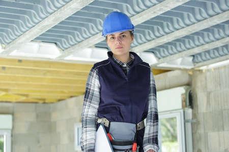 Photo pour portrait of female builder on construction site - image libre de droit