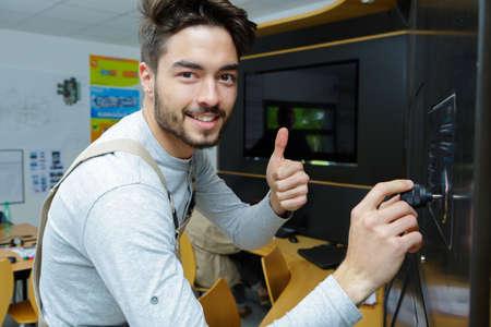 Photo pour male electrical engineer showing ok sign - image libre de droit