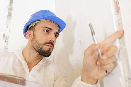 Photo pour young man inspecting building site - image libre de droit