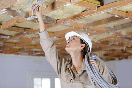 Photo pour a female builder inside construction - image libre de droit