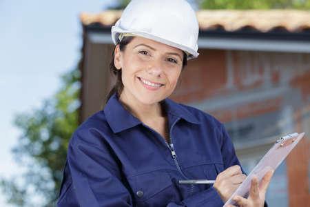 Photo pour female inspectorengineer looking at camera - image libre de droit