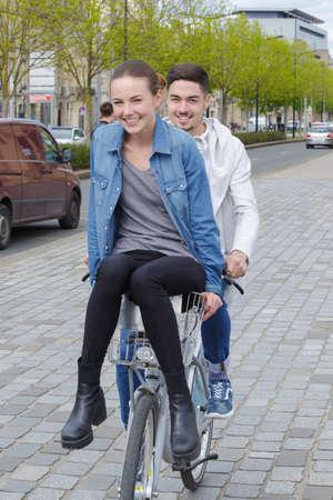 Photo pour happy young couple with bike - image libre de droit