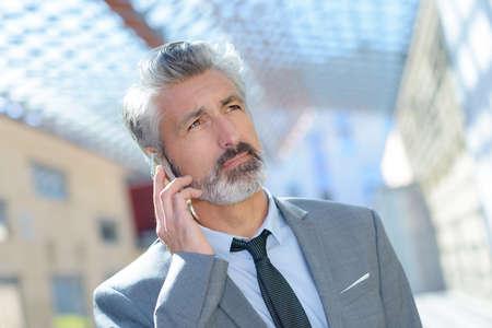 Photo pour portrait of businessman on the phone - image libre de droit