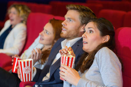 Photo pour couple at the cinema watching an horror movie - image libre de droit
