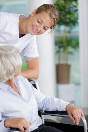Photo pour nurse caring about elder woman - image libre de droit