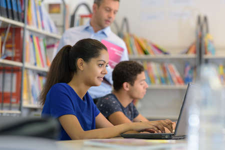 Photo pour Close up of students in library - image libre de droit