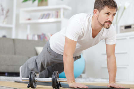 Photo for young man doing plank exercise at home - Royalty Free Image