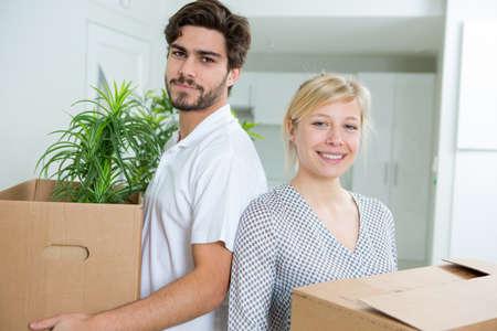 Photo pour happy young couple unpacking or packing boxes - image libre de droit