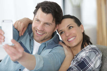 Photo pour a couple doing a slefie - image libre de droit