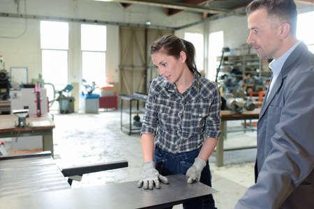 Photo pour woman working with sheet metal - image libre de droit