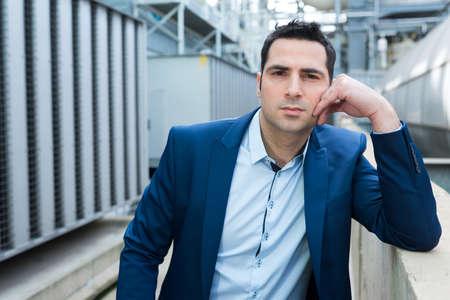Photo pour portrait of suited man on industrial site - image libre de droit
