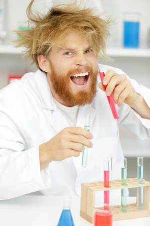 Photo pour crazy alchemist checks the test tubes - image libre de droit