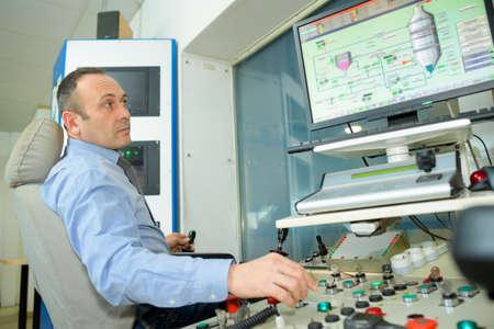 Photo pour man typing at factory computer - image libre de droit