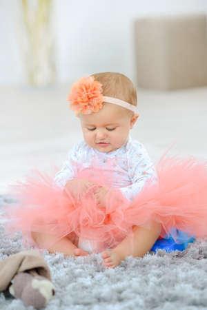 Photo pour a curious baby wears a skirt - image libre de droit