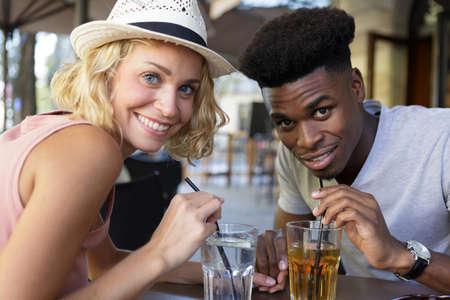 Photo pour an interracial couple on holidays - image libre de droit