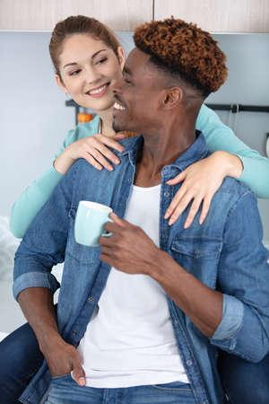 Photo pour happy couple at home having fun in love - image libre de droit
