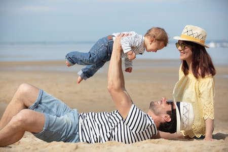 Photo pour portrait of happy family and a baby - image libre de droit