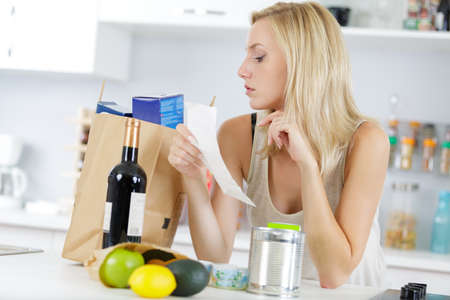 Photo for woman checking shopping bag with food - Royalty Free Image