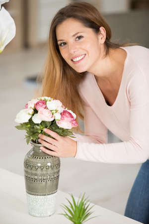 Photo pour photo of pretty lady holding big bunch of flowers - image libre de droit
