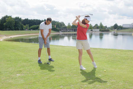 Photo for couple of golf players on the course - Royalty Free Image