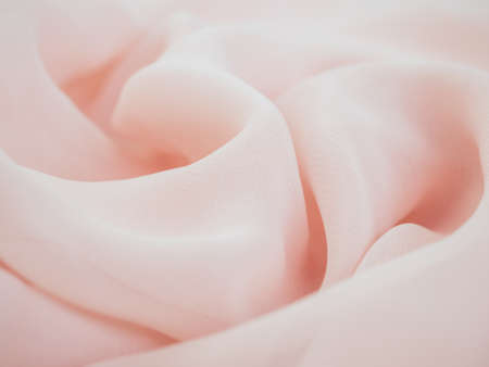 Photo pour Delicate wavy pastel material, pink glossy textile. Pastel backdrop with curves, luxury fashion. Smooth wrinkled chiffon fabric background. Abstract crumpled texture. Soft focus - image libre de droit