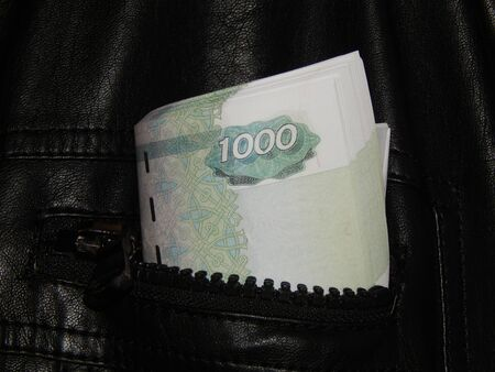 Russian money in the pocket of leather jacket