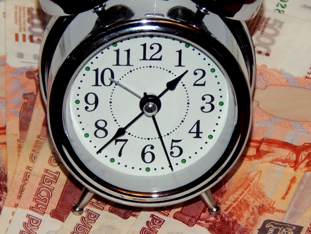 Russian currency on a white background with a clock