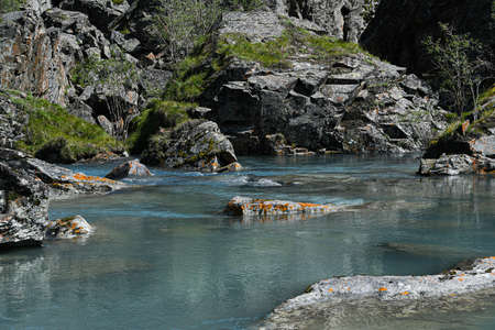 Photo pour rocky shore of sea, fast river in mountain valley, ocean surf on summer day - image libre de droit