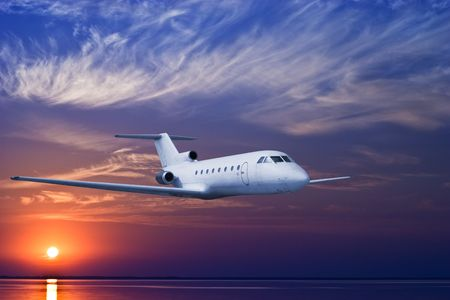 Airliner flying in high altitude at dusk