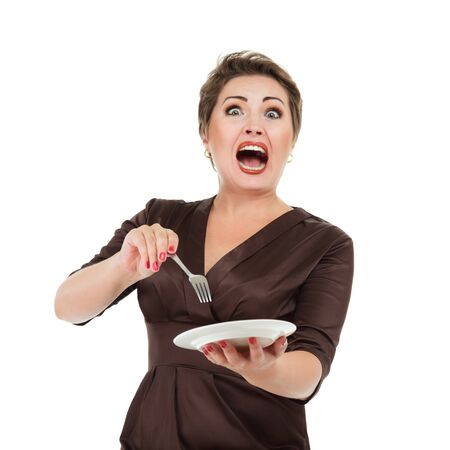 Emotional screaming woman with dish and fork in hands