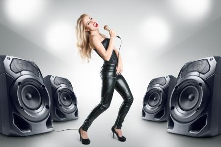 Karaoke singer at night in black leather clothing