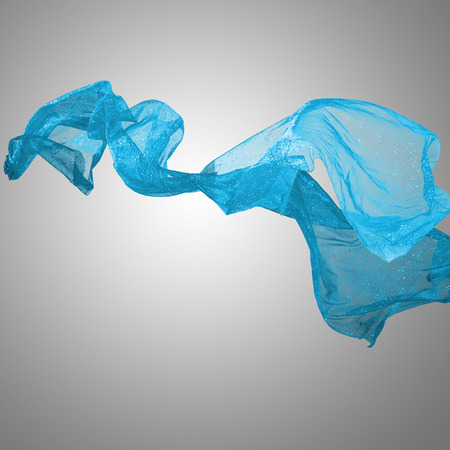 Abstract blue flying motion fabric over gray background