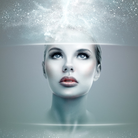Photo pour Abstract futuristic woman looking on a virtual display - image libre de droit