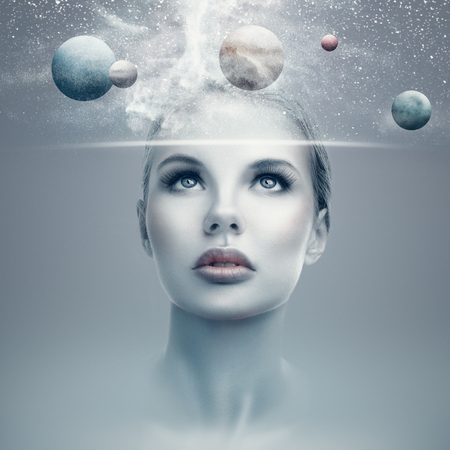 Photo for Futuristic portrait of young woman with virtual hologram display showing space and planets - Royalty Free Image
