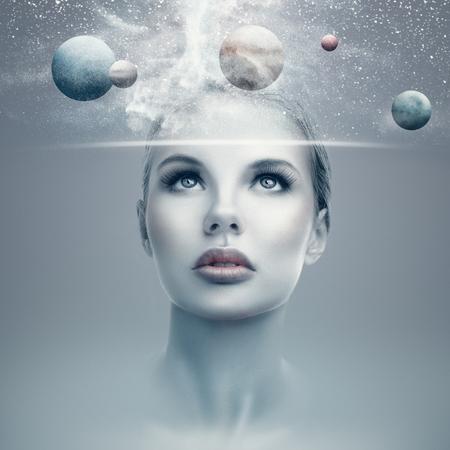 Foto de Futuristic portrait of young woman with virtual hologram display showing space and planets - Imagen libre de derechos
