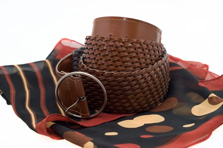 Women's braided brown leather belt with buckle at foulard on a white background
