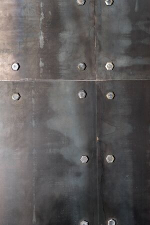 Background of the metal plates, bolted to the wall
