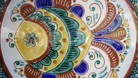 Clay products handmade folk Ukrainian traditional production of dishes, samples of art plates