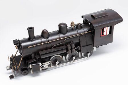 Photo pour Old train machine tin toy isolated on white - image libre de droit