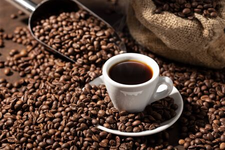 Photo pour Cup Of espresso Coffee and roasted beans. Coffee background - image libre de droit